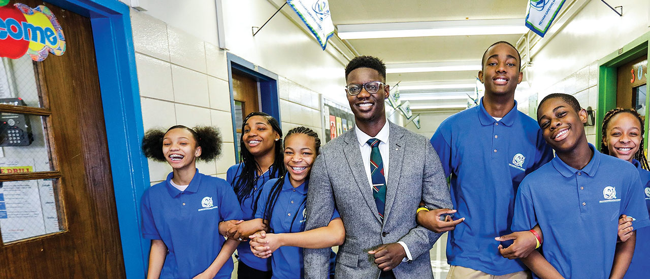 Edmund Adjapony with students.